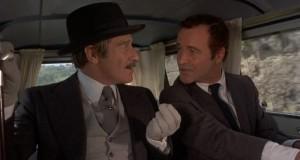 Клайв Ревилл в роли Карло, хозяина отеля