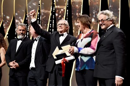 CANNES, FRANCE - MAY 22: Director Ken Loach (C) celebrates with Mel Gibson (L), screenwriter Paul Laverty (2nd L), producer Rebecca O'Brien and director and President of the Jury George Miller after being awarded the Palme d'Or for the movie 'I, Daniel Blake' during the closing ceremony of the annual 69th Cannes Film Festival at Palais des Festivals on May 22, 2016 in Cannes, France. (Photo by Pascal Le Segretain/Getty Images)