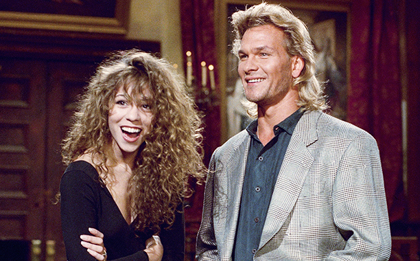 """Actor Patrick Swayze, right, and musical guest Mariah Carey rehearse Friday, Oct. 26, 1990 in New York for the Saturday, Oct. 27 broadcast of """"Saturday Night Live"""" in New York. (AP Photo/Richard Drew)"""